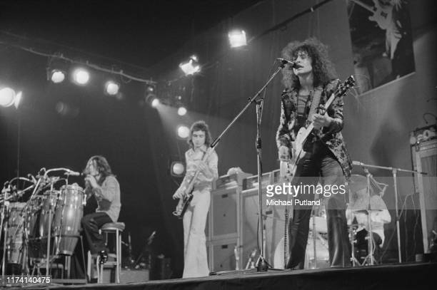 English glam rock group T Rex perform live on stage at the Empire Pool, Wembley in London on 20th March 1972. The band are, from left to right:...
