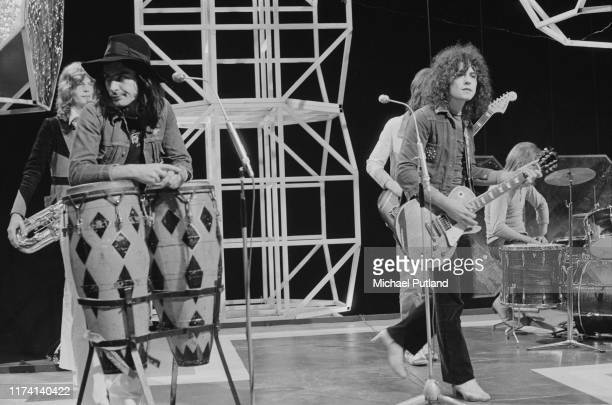 English glam rock group T Rex performing on the BBC music television show 'Top of the Pops', in London on 4th August 1971. Band members are, from...