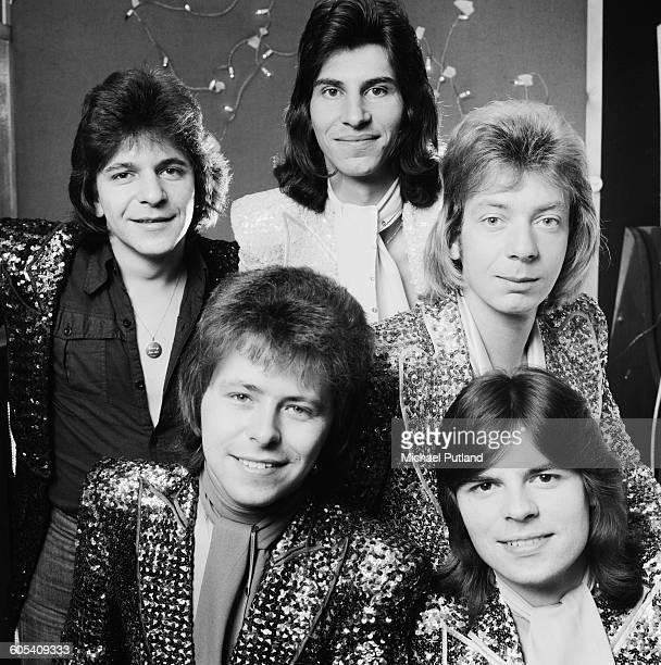 English glam rock group The Glitter Band 18th November 1975 Clockwise from bottom left singer/bassist John Springate guitarist Gerry Shephard drummer...