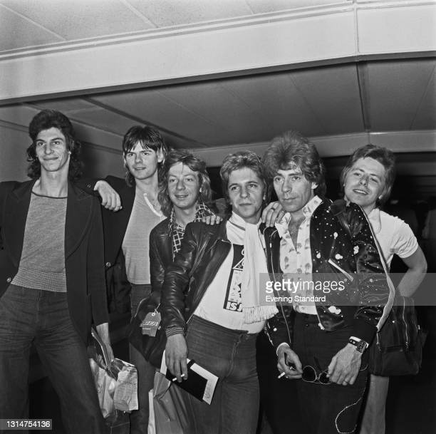 English glam rock group The Glitter Band, UK, 29th July 1974. From left to right, they are drummer Tony Leonard, drummer Pete Phipps, saxophonist...