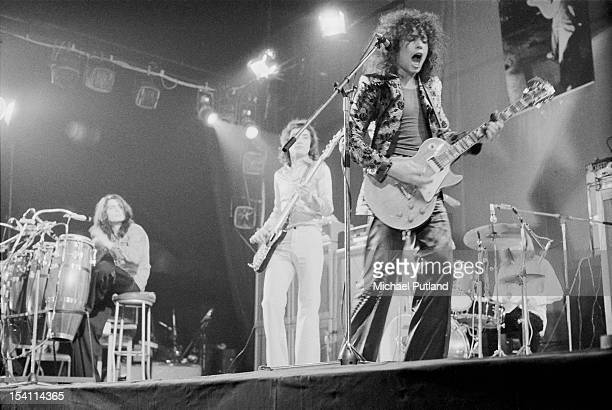 English glam rock group TRex performing at the Empire Pool Wembley London 20th March 1972 Left to right Mickey Finn Steve Currie Marc Bolan and Bill...