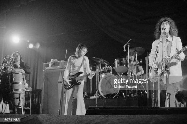 English glam rock group T-Rex performing at the Odeon, Birmingham, 9th June 1972. Left to right: Mickey Finn , Steve Currie , Bill Legend and Marc...