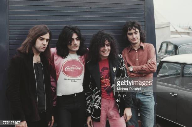 English glam rock group TRex posed together at the Weeley Festival ClactononSea Essex 27th August 1971 Left to right Bill Legend Mickey Finn Marc...