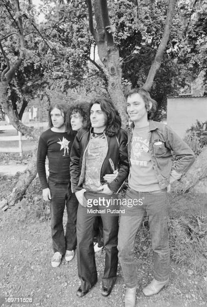 English glam rock group TRex posing for the camera during a fourdate British tour June 1972 Left to right drummer Bill Legend singer Marc Bolan...
