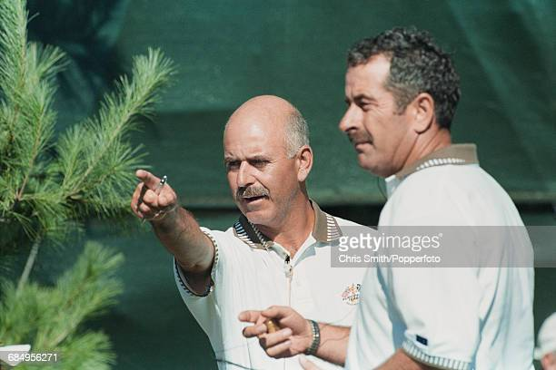English golfer and nonplaying captain of Team Europe Mark James pictured left with vice captain Sam Torrance as they discuss tactics during...