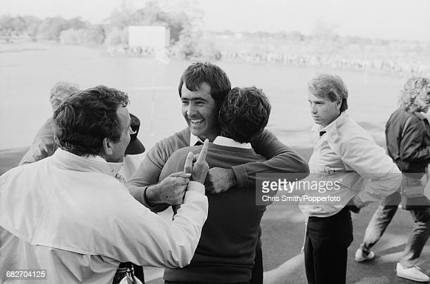 English golfer and nonplaying captain Tony Jacklin pictured left congratulating Spanish golfer Seve Ballesteros as English golfer Paul Way looks on...