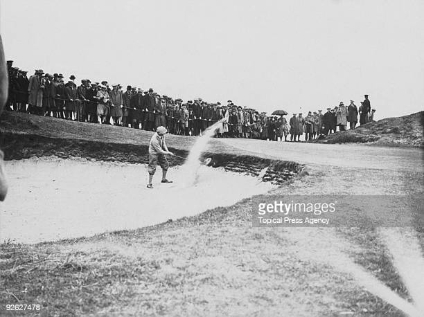 English golfer Arthur Havers plays from a bunker during the Open Golf Championship at Troon, Scotland, June 1923.