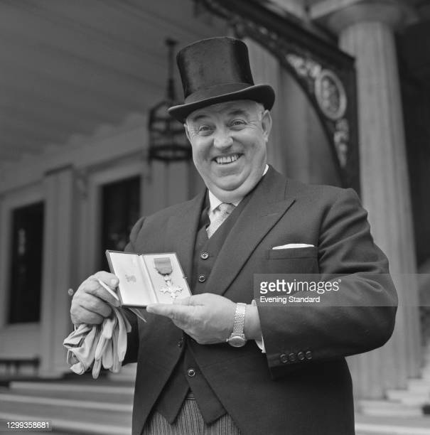 English golfer Bill Cox receives an OBE at Buckingham Palace in London, UK, 25th October 1967.