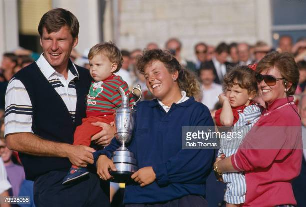 English golfer Nick Faldo celebrates with his family and caddie Fanny Sunesson after winning the British Open Golf Tournament held at St Andrews...