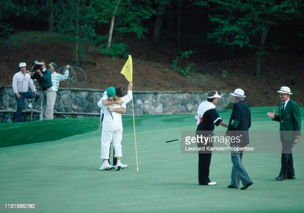 English golfer Nick Faldo hugs his caddy Fanny Sunesson after winning the US Masters Golf Tournament for the second consecutive year at the Augusta...