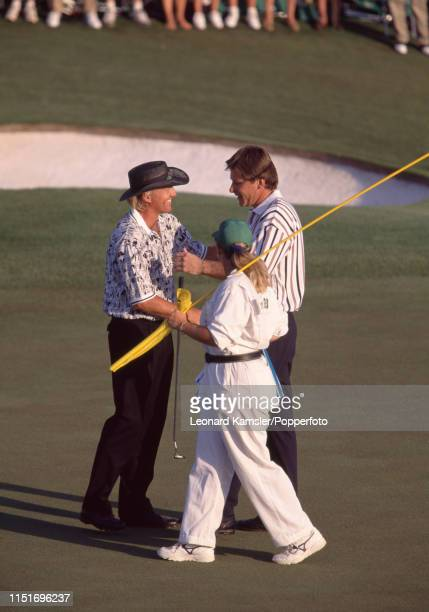 English golfer Nick Faldo is congratulated by Greg Norman of Australia whom Faldo defeated by five strokes to win the US Masters Golf Tournament at...
