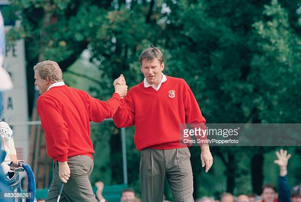English golfer Nick Faldo pictured on right shaking hands with Scottish golfer Colin Montgomerie of Team Europe during play to lose the 1993 Ryder...