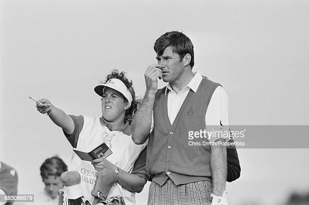 English golfer Nick Faldo pictured with his caddy Fanny Sunesson during competition to win the 1990 Open Championship by five strokes to become...