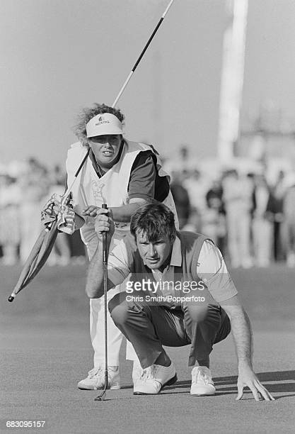 English golfer Nick Faldo pictured with his caddy Fanny Sunesson during competition to win the 1990 Open Championship to become champion on the Old...