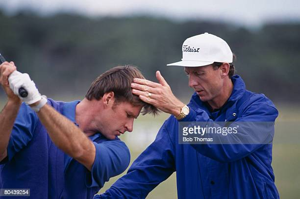 English golfer Nick Faldo with his coach David Leadbetter during the British Open Golf Championship held at Muirfield Scotland 15th 19th July 1992...