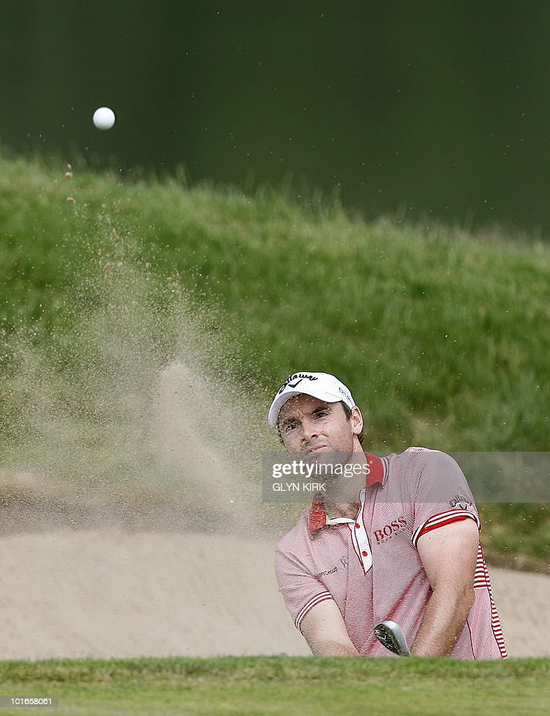 English golfer Oliver Wilson plays out of a bunker at the 12th green during the final round of the Celtic Manor Wales Open on The Twenty Ten Course in Newport, Wales on June 6, 2010.