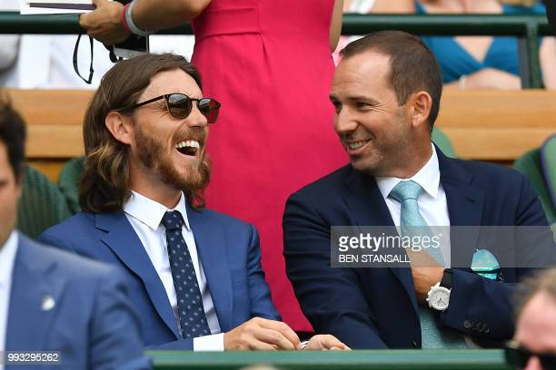 English golfer Tommy Fleetwood and Spanish golfer Sergio Garcia takes their seat in the Royal box on Centre Court Spain's Rafael Nadal plays against...