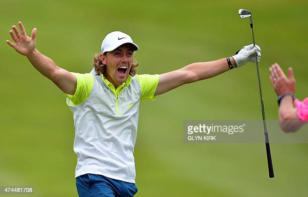 English golfer Tommy Fleetwood celebrates holing his second shot to the 4th green for an albatross on the third day of the PGA Championship at...