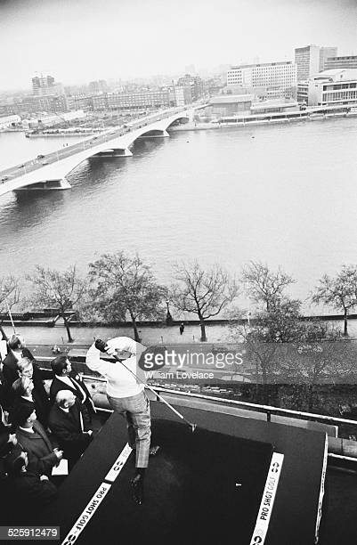 English golfer Tony Jacklin attempting the longest drive record from the roof of the Savoy Hotel across the River Thames, London, 1969.