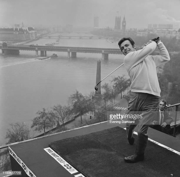 English golfer Tony Jacklin tees off from the Savoy Hotel, London, UK, 27th November 1969.