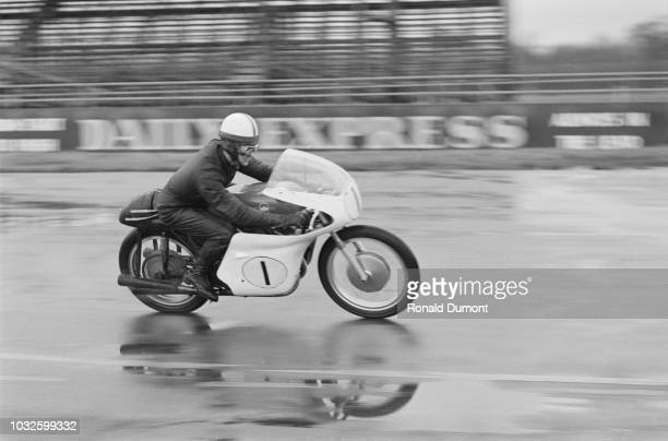 English grand prix motorcycle road racer Derek Minter of the Gilera team pictured riding a 500cc Gilera motorcycle during testing at Silverstone...