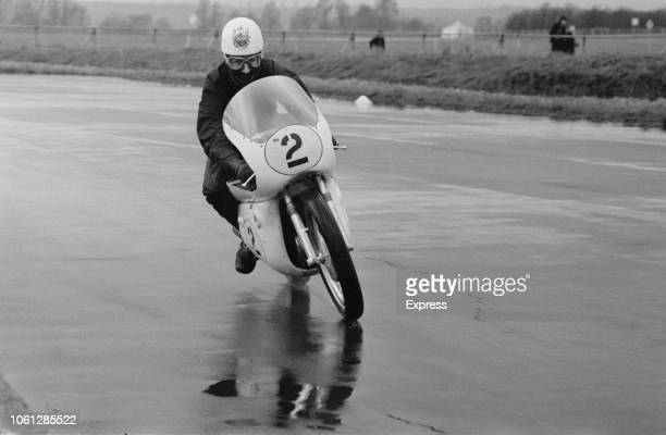 English grand prix motorcycle road racer John Hartle of the Gilera team pictured riding a 500cc Gilera motorcycle during testing at Silverstone...
