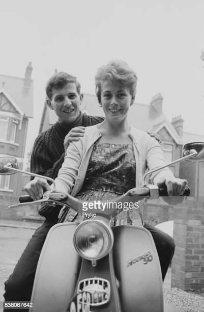 English Grand Prix motorcycle road racer Phil Read nicknamed 'The Prince of Speed' teaches his wife Madeleine how to drive a Honda 50 motorcycle 18th...