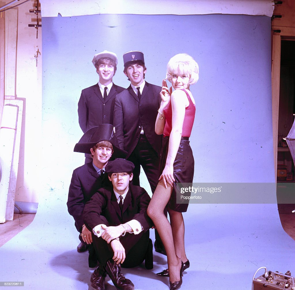 English group The Beatles posed with a female actress and wearing a variety of french hats including a kepi and beret in Paris in January 1964. Clockwise from top left: John Lennon (1940-1980), George Harrison (1943-2001), Paul McCartney and Ringo Starr.