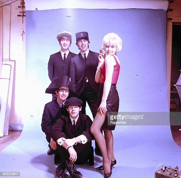 English group The Beatles posed with a female actress and wearing a variety of french hats including a kepi and beret in Paris in January 1964...