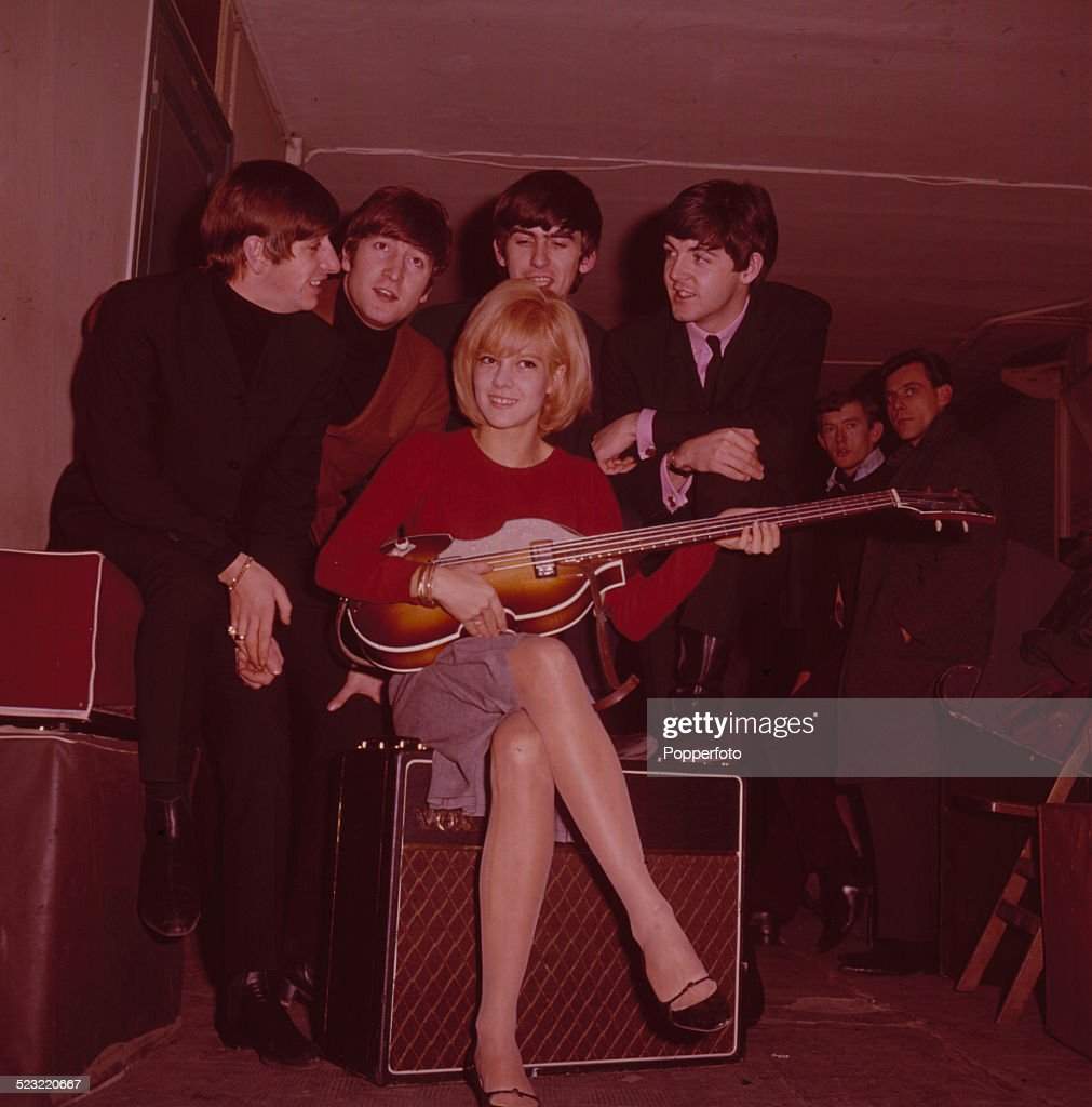 English group The Beatles posed with French singer Sylvie Vartan in Paris in January 1964. From left to right: Ringo Starr, John Lennon (1940-1980), Sylvie Vartan, George Harrison (1943-2001) and Paul McCartney.