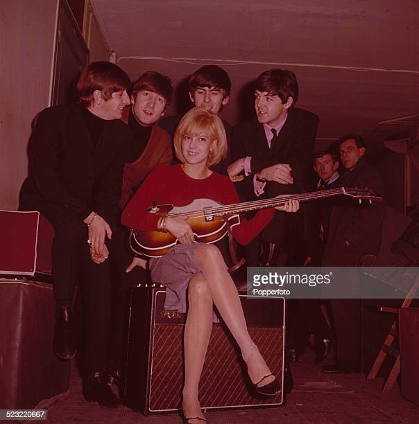 English group The Beatles posed with French singer Sylvie Vartan in Paris in January 1964 From left to right Ringo Starr John Lennon Sylvie Vartan...