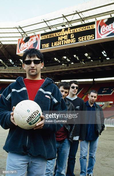 English group the Lightning Seeds at Wembley Stadium in London circa 1996 Left to right are singer Ian Broudie drummer Chris Sharrock bassist Martyn...