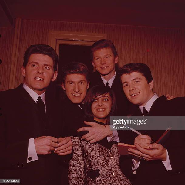English group The Searchers posed with a fan seeking autographs backstage during a recording of the television music series 'Thank Your Lucky Stars'...