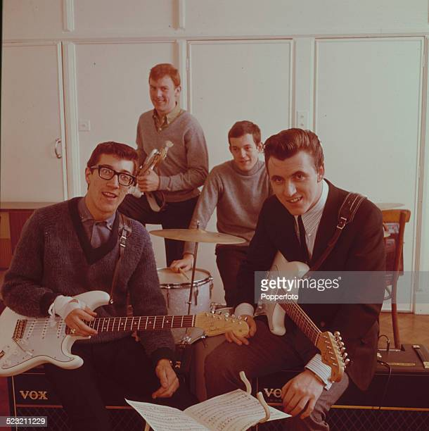 English group The Shadows posed together backstage in England in 1963 From left to right Guitarist Hank Marvin bass guitarist Brian 'Licorice'...