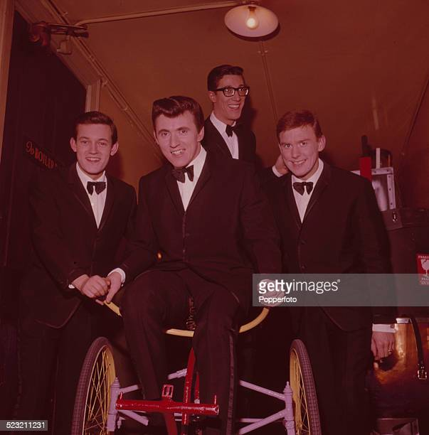 English group The Shadows posed together backstage in England in 1963 From left to right Drummer Brian Bennett guitarist Bruce Welch guitarist Hank...