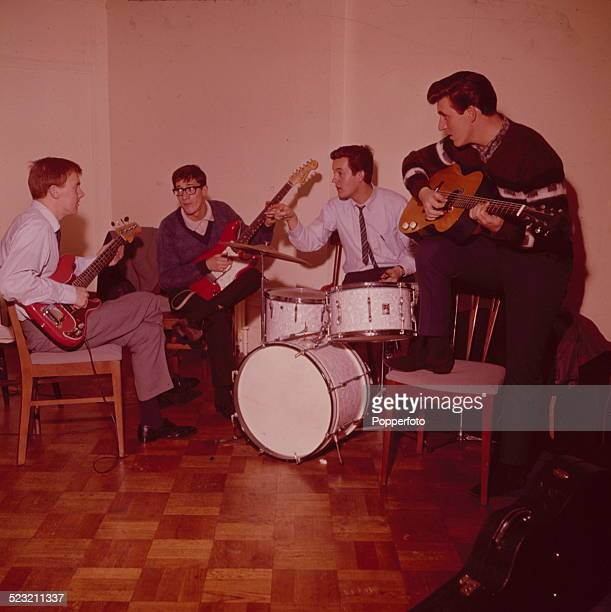 English group The Shadows rehearse together backstage in England in 1963 From left to right Bass guitarist Brian 'Licorice' Locking guitarist Hank...