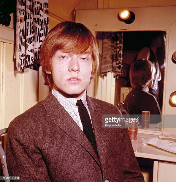 English guitarist and member of The Rolling Stones Brian Jones posed in a dressing room in 1963