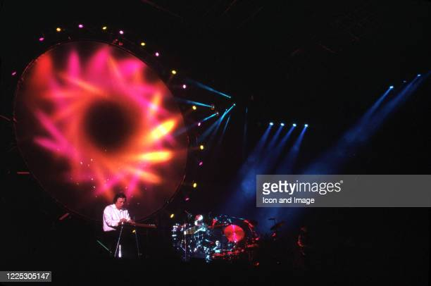 """English guitarist and singer David Gilmour and English drummer, best known as a founder member of Pink Floyd, Nick Mason, perform during the 1987 """"A..."""