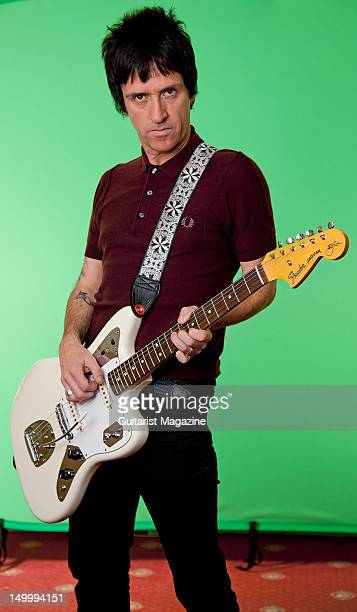 English guitarist and songwriter Johnny Marr best know as the guitarist of English alternative rock band The Smiths during a portrait shoot for...
