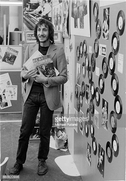 English guitarist and songwriter Pete Townshend of The Who with copies of the magazine Beat Instrumental at a music show United Kingdom 1971