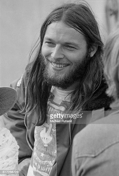English guitarist David Gilmour, of Pink Floyd, at a free concert in Hyde Park, London, 31st August 1974. He is performing with Roy Harper, John Paul...
