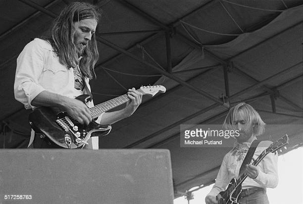 English guitarist David Gilmour on stage with singer-songwriter Roy Harper at a free concert in Hyde Park, London, 31st August 1974. They are...