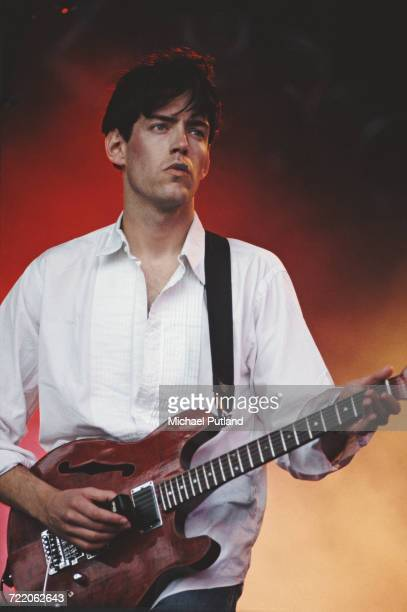 English guitarist Ed O'Brien performs live onstage with Radiohead at the Glastonbury Festival at Pilton in Somerset England on 26th June 1994