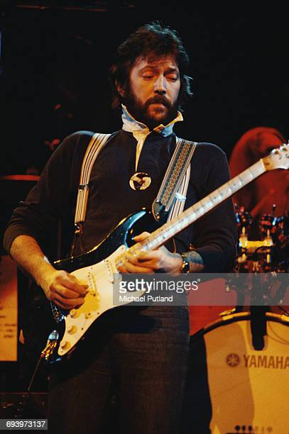 English guitarist Eric Clapton performing on stage, 1975.
