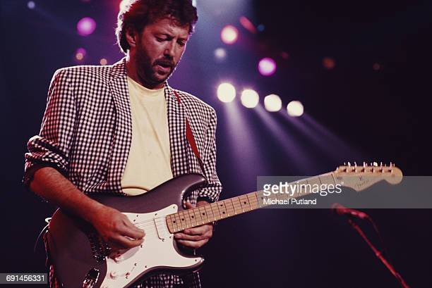 English guitarist Eric Clapton performing on stage at The Prince's Trust all-star Rock Gala at Wembley Arena, London, 5th June 1987.
