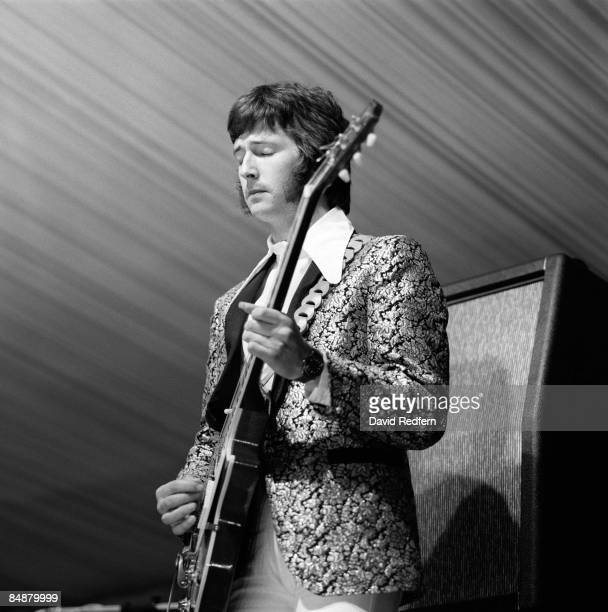 English guitarist Eric Clapton performing with Gibson Les Paul guitar on stage with British rock group Cream during their first live appearance at...
