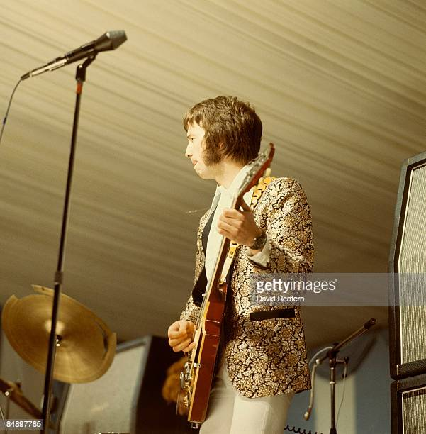 English guitarist Eric Clapton performing with Gibson Les Paul guitar with Bigsby vibrato on stage with British rock group Cream during their first...