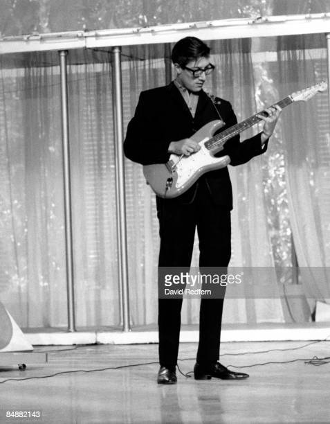 English guitarist Hank Marvin of The Shadows performs live on stage playing a Fender Stratocaster guitar with tremelo arm at the Palladium Theatre in...