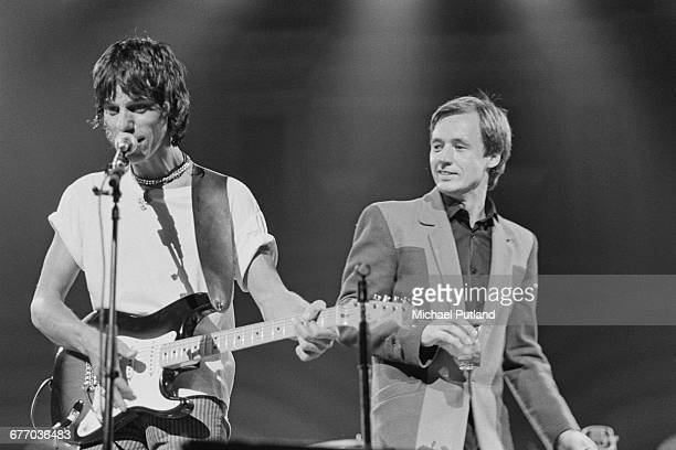 English guitarist Jeff Beck and Welsh guitarist and singer Andy Fairweather Low performing on stage at a charity concert for ARMS held at the Royal...