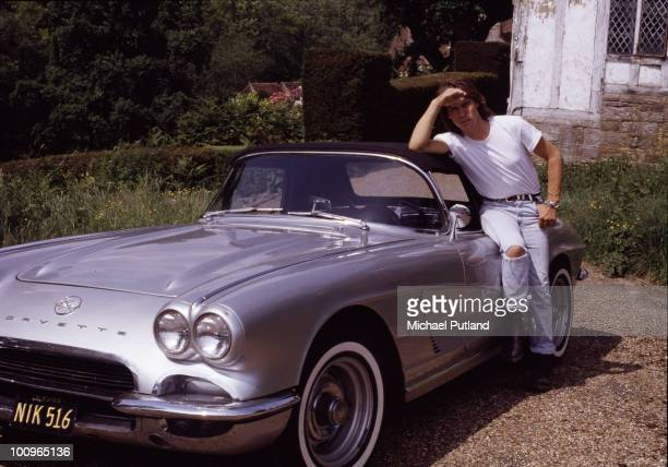 English guitarist Jeff Beck at his home with one of his Chevrolet Corvettes, UK, 1989.